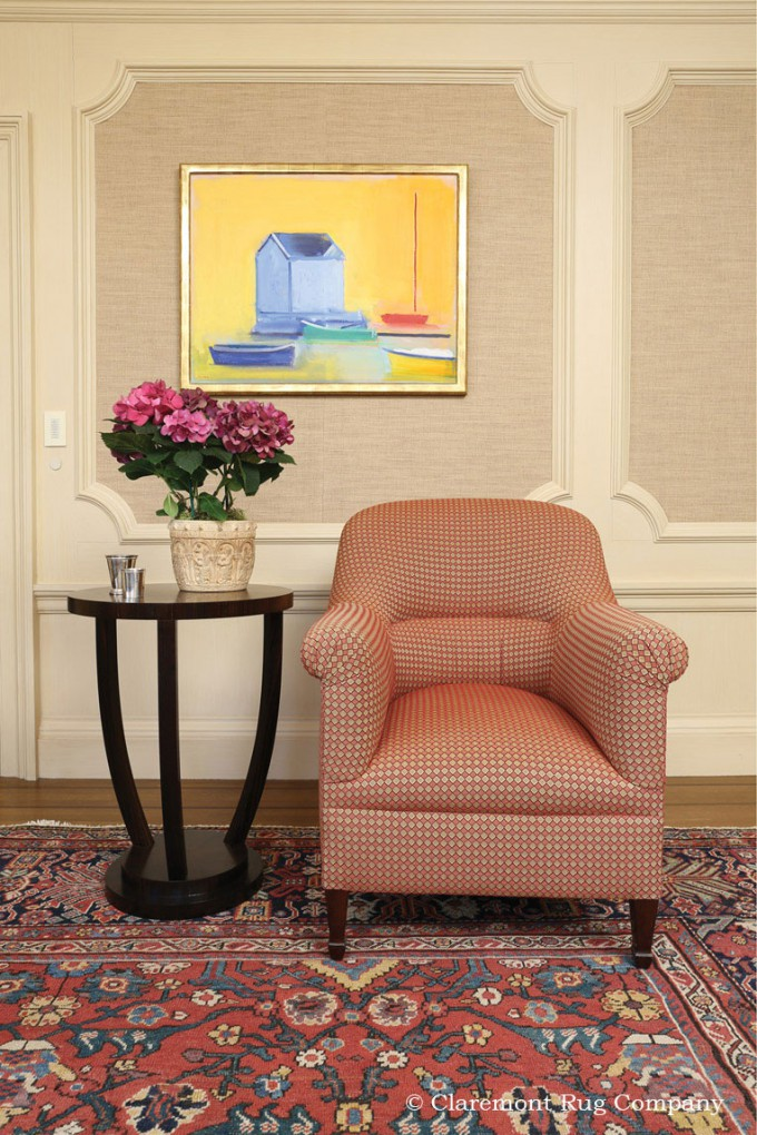 Sultanabad antique rug paired with modern art in a sitting room