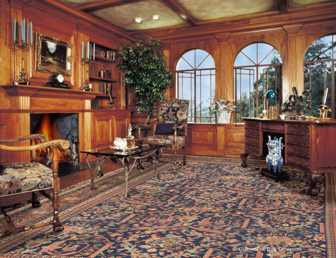 Persian Sultanabad Antique Carpet Sets Off Wood Paneling in traditional library