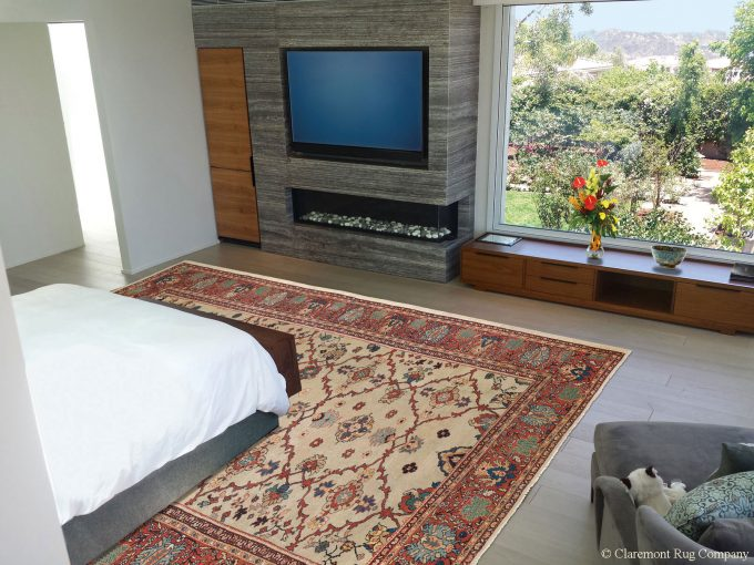 Persian Sultanabad antique rug in Los Angeles California modern bedroom