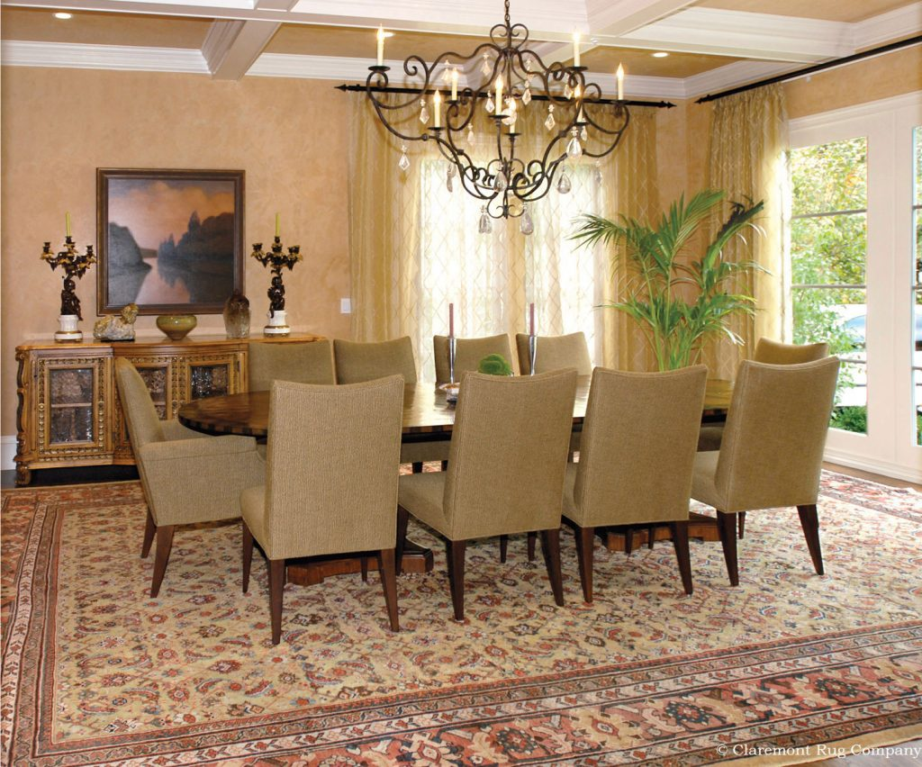 Antique Persian Sultanabad oversize antique rug in dining room of traditional Silicon Valley home