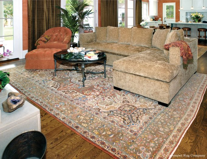 Persian Tabriz antique carpet in traditional family room Silicon Valley