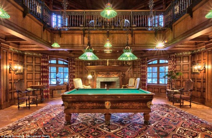 A Bakhtiari antique rug is a focal point in this grand billards room