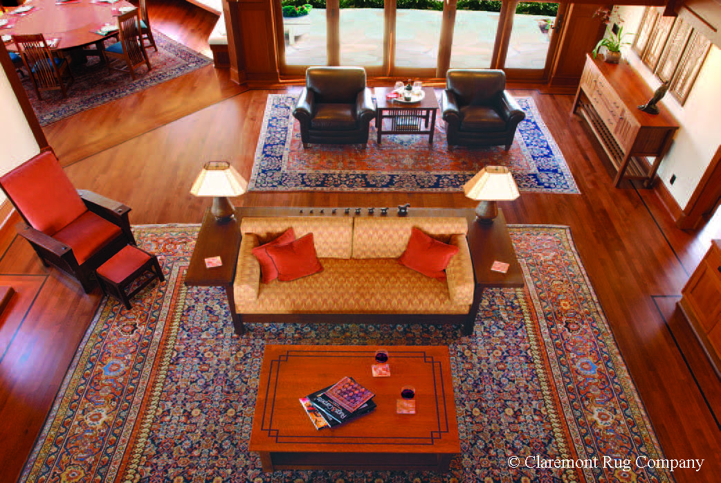 LEVEL 4–HIGH-DECORATIVE This suite of three singular late 19th century Persian Sultanabad carpets offers compatible design themes and similar color palettes to create a harmonious ambiance in this home on the California coast. Carla Carstens Designs.