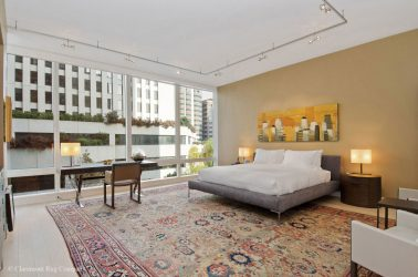 San Francisco contemporary condo with rare green sultanabad antique rug in Master Bedroom