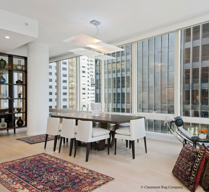 San Francisco California modern condo with antique carpets Dining room with Bidjov Caucasian rugs