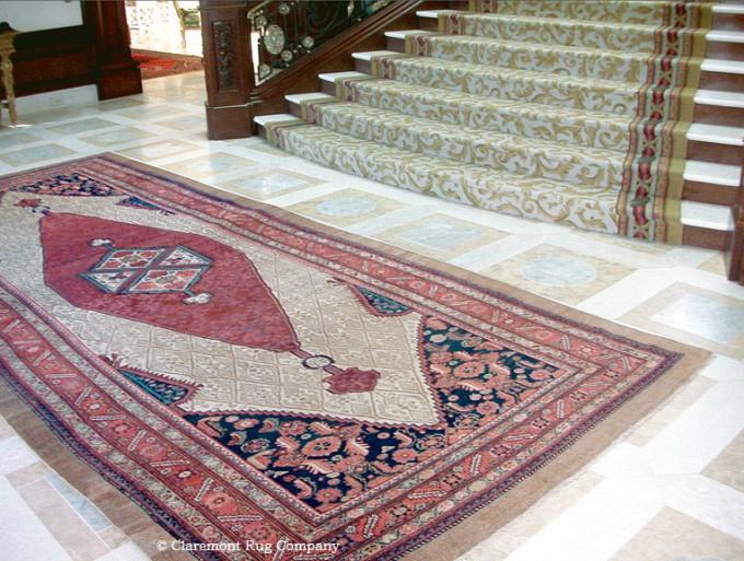 ntique Camelhair rug in grand entryway