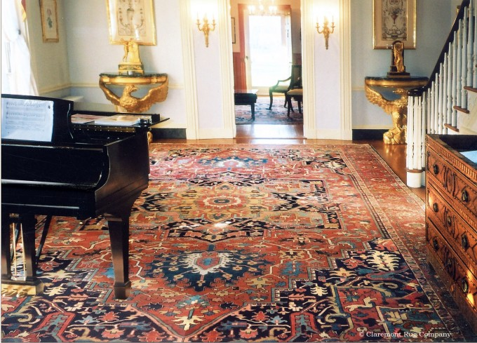Part of a large suite of rugs that grace a Jeffersonian colonial residence, this 19th century Serapioversizecarpet epitomizes this style's majestic patterning and glorious coloration.