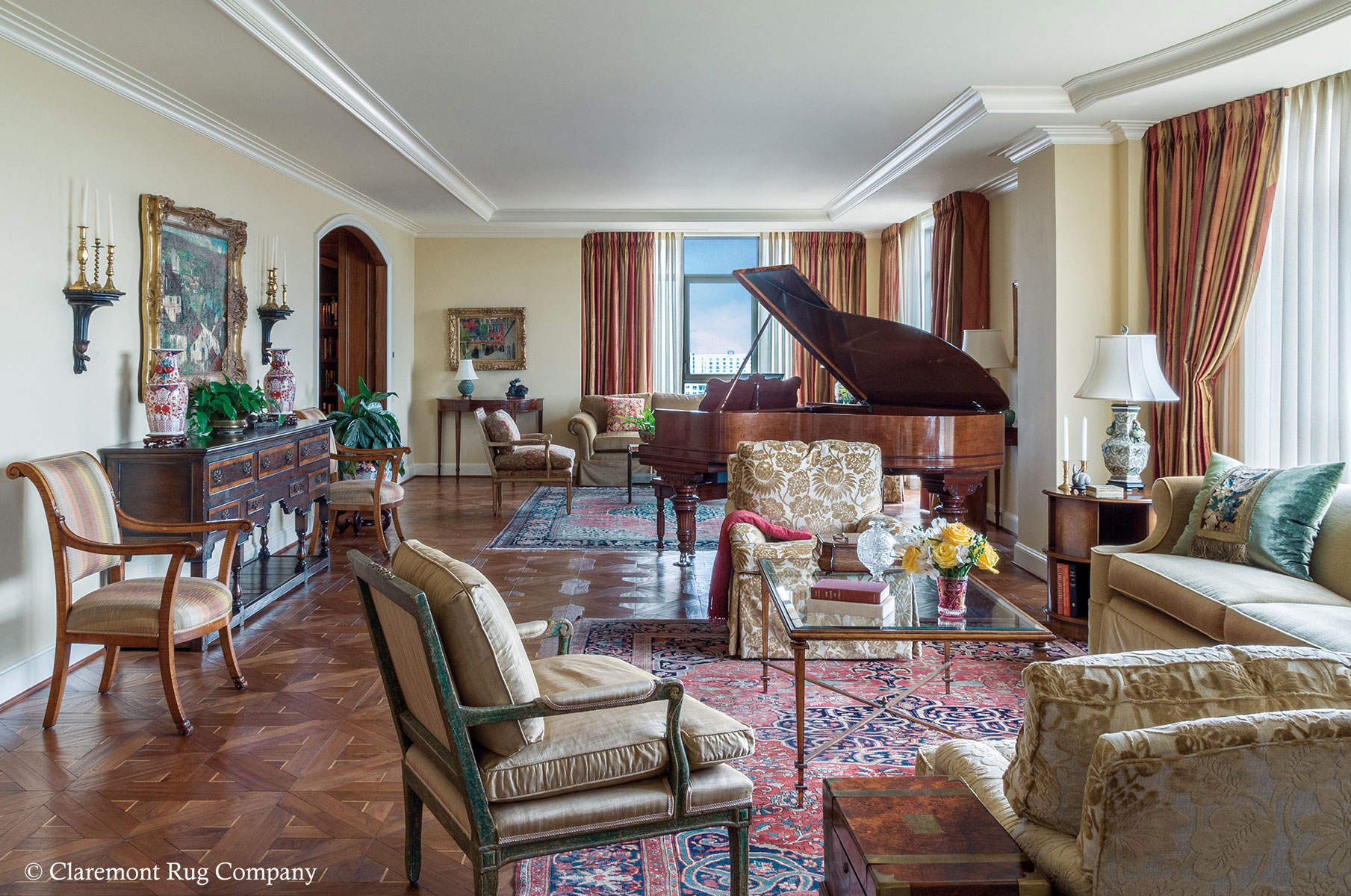 A Duo Of Outstanding Antique Ferahan Sarouk Carpets Unify A Gracious Old World Living Room