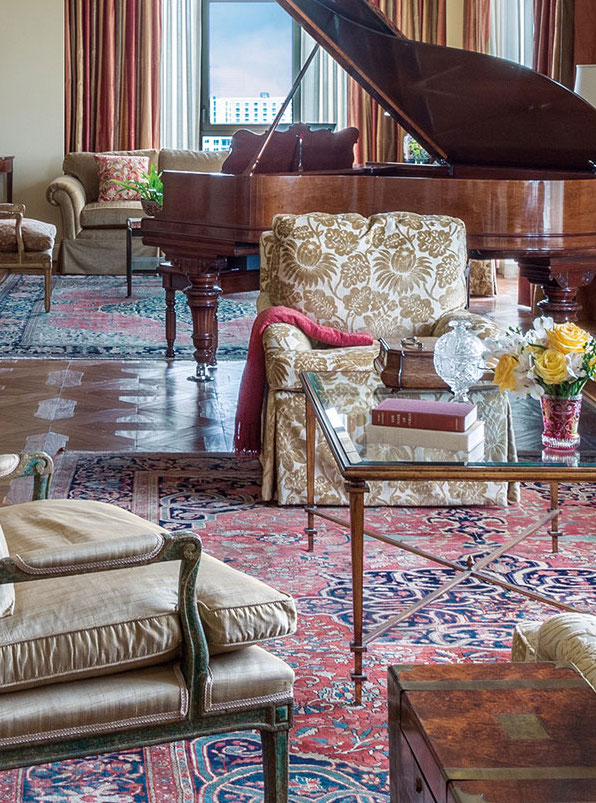 A memorable Whole Home Rug Display in the Houston penthouse of a financial executive favors 19th century Persian town carpets, notably distinctive Ferahan Sarouks. (Decor: Marianne Michaels Interior Design.)