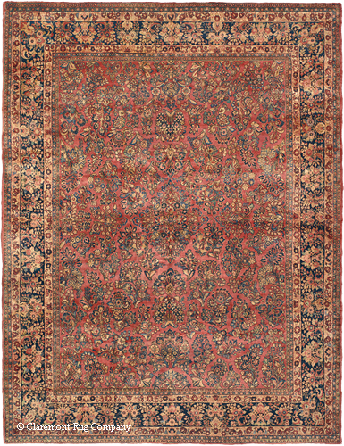 Vintage Persian Sarouk, 10ft 2in x 13ft 3in, circa 1925, a first-quality carpet woven for export. Note the consistency of the pattern throughout the field and borders, the classical design of a series of bouquets and the more limited color palette.
