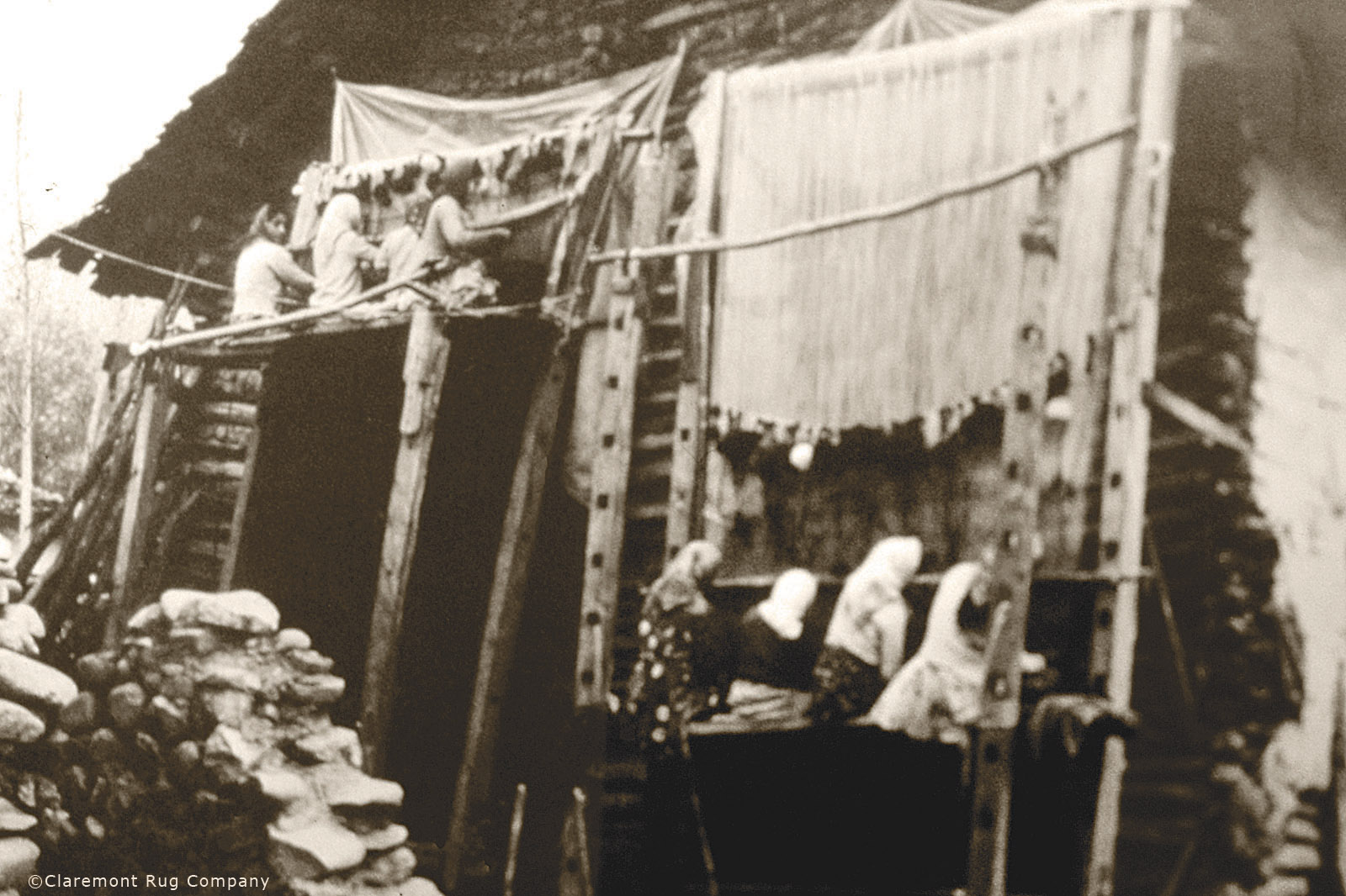 Weavers working on vertical loom Azerbaijan, circa 1900