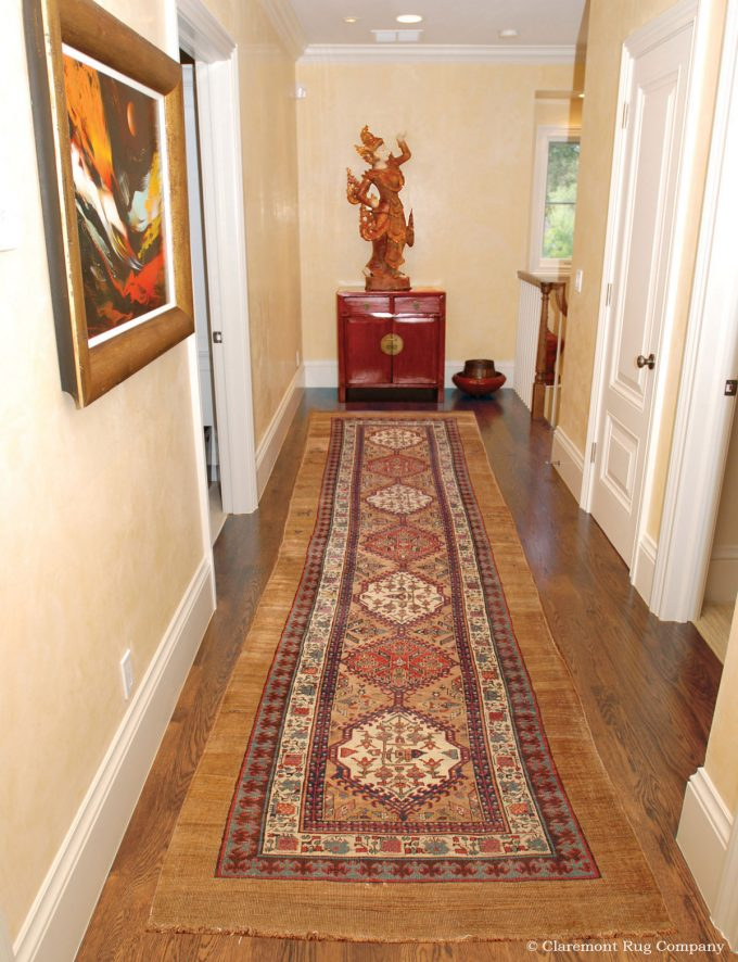 antique Serab camelhair runner rug in traditional hallway of Silicon Valley home with art