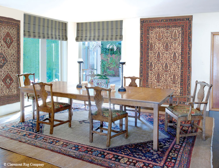 Extremely rare ivory ground South Persian Qashqai rug (left) and Afshar (right) are the wall art of this client's breakfast room, where they can enjoy the many nuances of color and design in these masterpiece Oriental carpets. They are complemented by the soft hues of an antique Malayer Camelhair carpet under the table.