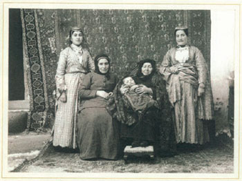 Five generations of an Armenian family. The rug behind them and the one on the floor appear to be Persian. Ottoman Turkey, 1893.