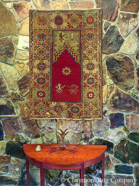 LEVEL 2–HIGH COLLECTIBLE Turkish Bergama rug, circa 1800, displayed as wall art.