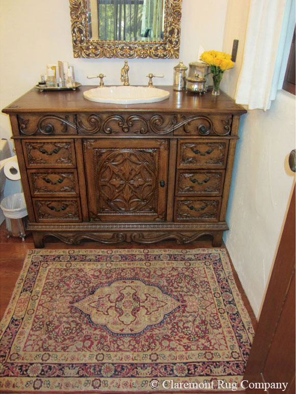 ANtique Persian Rug adds glamour to spa bathroom