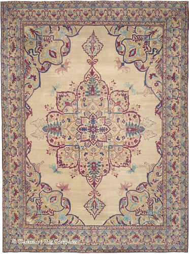 This extremely rare, mid-19th century, oversize Kermanshah carpet was part of a private collection for most of its life. It boasts a highly unique, vine-formed blossom medallion balanced by lush corner pieces. Inspired by the rhythm and grace experienced in the natural and celestial worlds, the great artist-weavers perfectly married color and design. Their profuse ornamentation and myriad color hues created a world overflowing with energy, yet always at peace and in unity.