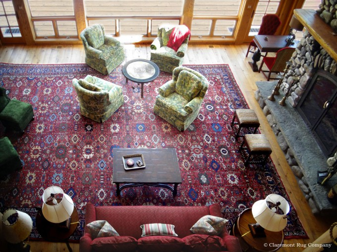 ountain Cabin Featuring a Rich Antique Sultanabad Persian Rug in Rustic Great room