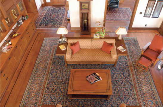 These clients chose an extensive collection of late 19th century Persian village carpets to adorn the floors throughout their expansive Arts & Crafts home. An open floor plan allows the dramatic viewing of up to six rugs at one time. Designer: Carla Carstens, Carla Carstens Interior Design.