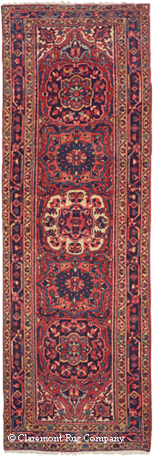 semi-antique Heriz, circa 1950. Woven in the same locale as the Serapi eight decades later, using chemical dyes, its colors are rather harsh and entirely consistent, devoid of any nuance of hue.